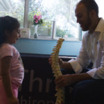 Dr. Tony Vizzini provides free scoliosis screenings for 25 students at Child's Path